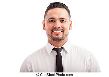 Hispanic man wearing a tie
