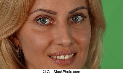 Portrait of a gorgeous blonde woman smiling to the camera