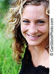 Portrait of a gorgeous woman at the park - Portrait of a ...