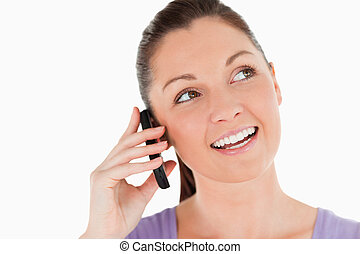 Portrait of a gorgeous woman on the phone while standing