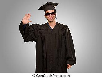 Portrait Of A Graduate Man Waving