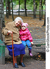 portrait of a grandmother and granddaughter in the garden