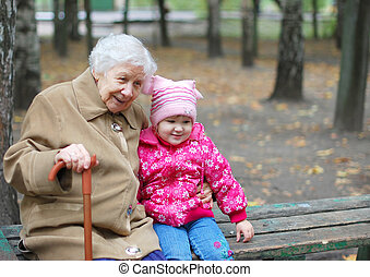 portrait of a grandmother and granddaughter in the park