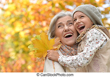 Portrait of a grandmother and granddaughter outdoors