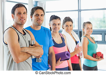 Portrait of a group of fitness class standing in row