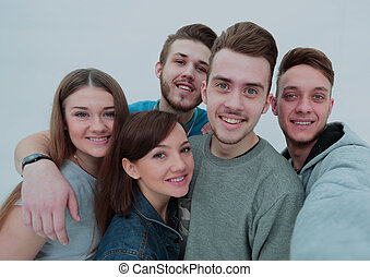 portrait of a group of friends. the young people stand side by s