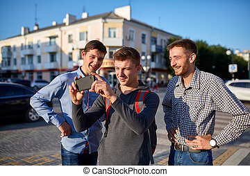 Portrait of a group of smiling friends, preparing for making...