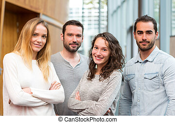 Portrait of a group of young attractive workers