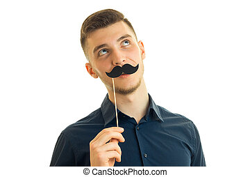 Portrait of a guy with a paper mustache isolated on white...