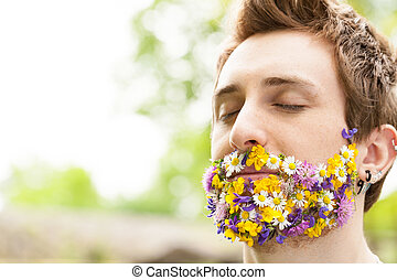 portrait of a guy with flowers instead of his beard relaxed ...