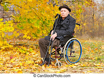 Portrait of a handicapped man in his wheelchair