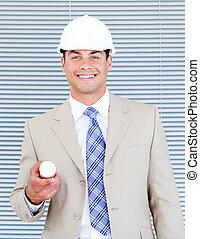 Portrait of a handsome architect holding blueprint