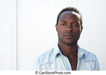 Portrait of a handsome black man against white background