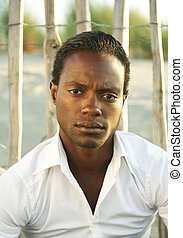 Portrait of a handsome black man in white shirt