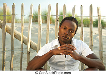 Portrait of a handsome black man relaxing outdoors