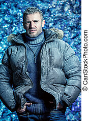 winter - Portrait of a handsome brutal man dressed in winter...