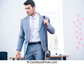 Portrait of a handsome businessman with bag