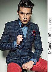 Portrait of a handsome fashion man sitting