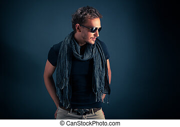 portrait of a handsome guy, wearing sunglasses
