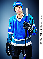 hockey stick - Portrait of a handsome ice-hockey player with...