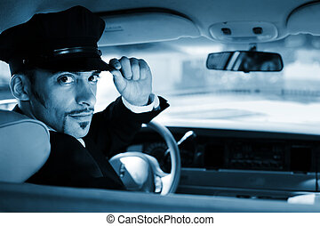 Portrait of a handsome male chauffeur sitting in a car saluting a viewer.