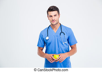 Portrait of a handsome male doctor holding apple