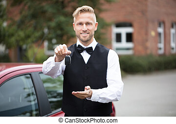 Male Valet Holding Car Keys - Portrait Of A Handsome Male...