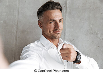 Portrait of a handsome man in white shirt