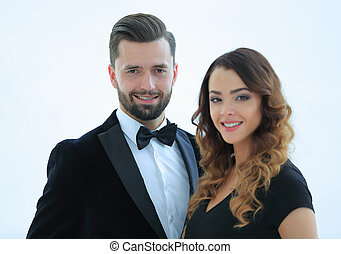 Portrait of a handsome man looking at the camera with a woman