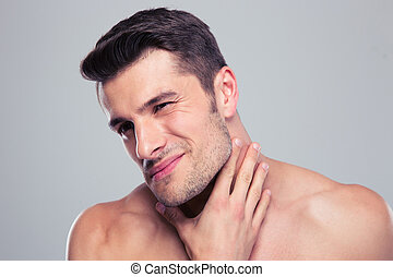 Portrait of a handsome man with neck pain