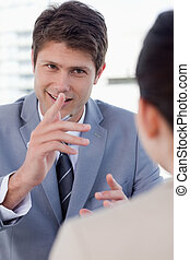 Portrait of a handsome manager interviewing a female...
