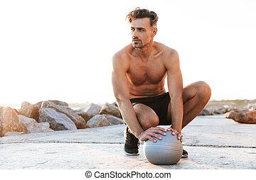 Portrait of a handsome shirtless sportsman