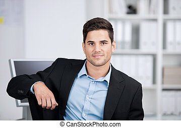 Portrait of a handsome smiling businessman