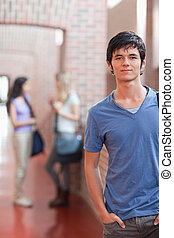 Portrait of a handsome student posing
