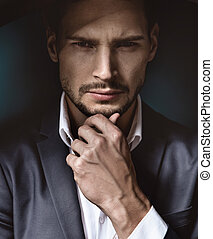 Portrait of a handsome, thoughtdul businessman - Portrait of...