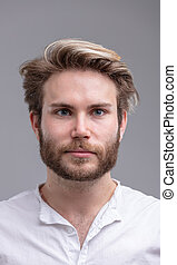 Portrait of a handsome young bearded man thinking