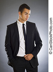 young business man isolated over dark background