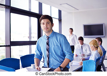 Portrait of a handsome young business man on a meeting in ...