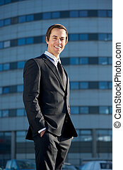 Portrait of a handsome young business man smiling outside the office