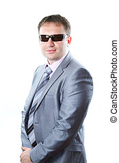Portrait of a handsome young  businessman in glasses in suit isolated on white background