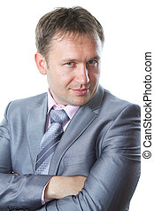 Portrait of a handsome young  businessman in suit isolated on white background