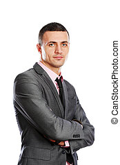 Portrait of a handsome young businessman in suit over white...