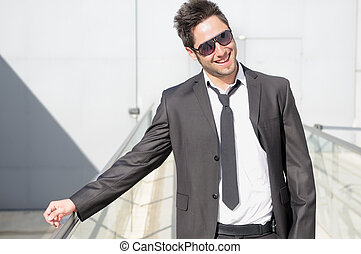 Portrait of a handsome young businessman laughing