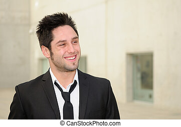 Portrait of a handsome young businessman smiling