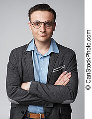 Portrait of a handsome young businessman wearing glasses isolated