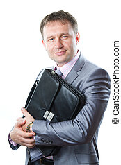 Portrait of a handsome young  businessman with bag in suit isolated on white background