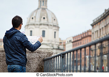 Portrait of a handsome, young, male tourist in Rome, Italy