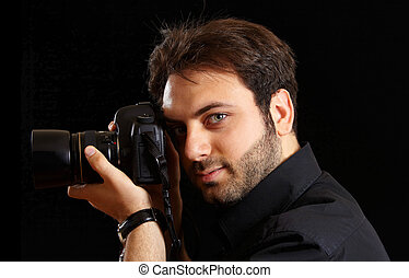 Portrait of a handsome young man with camera