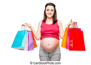 Portrait of a happy and beautiful future mother with shopping on a white background