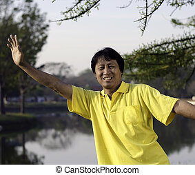 portrait of a happy asian man in park